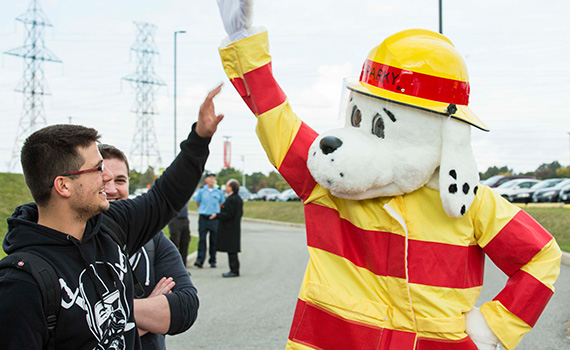 Fire Prevention Event - High Fiving Sparky the Fire Dog
